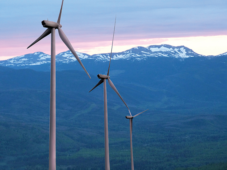 Wind turbines in bc, mountains in background